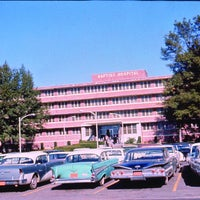 Baptist Hospital front entrance with snazzy cars.