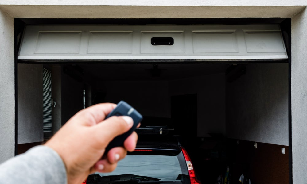 Hand use remote controller for closing and opening garage door.jpeg
