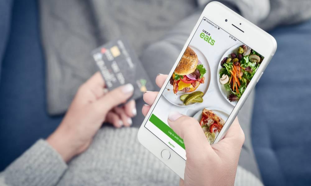 Woman orders food on Uber eats app (1).jpg