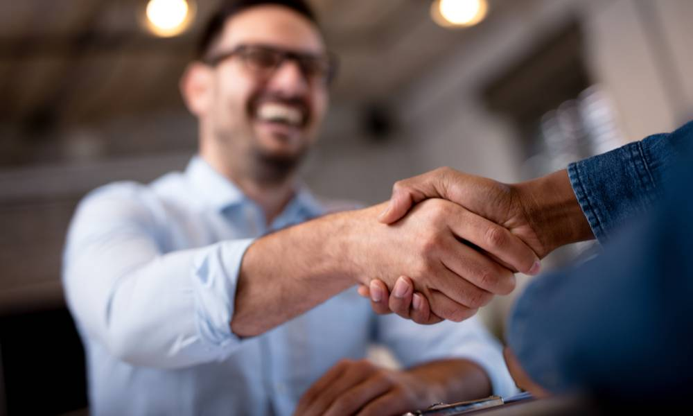 Two men shake hands during a metting.jpeg