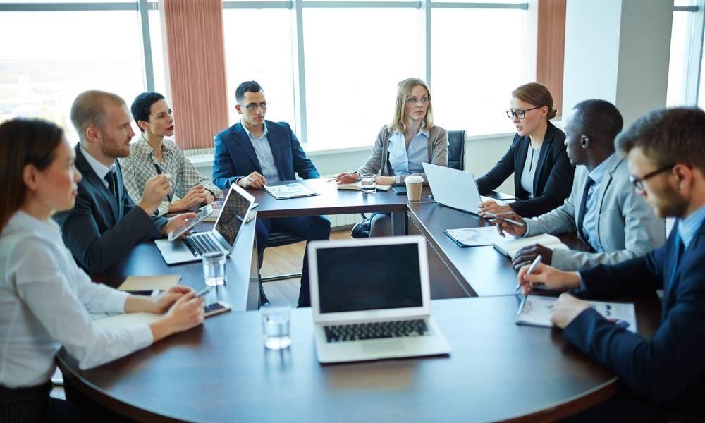 Meeting of shareholders around a table.jpg
