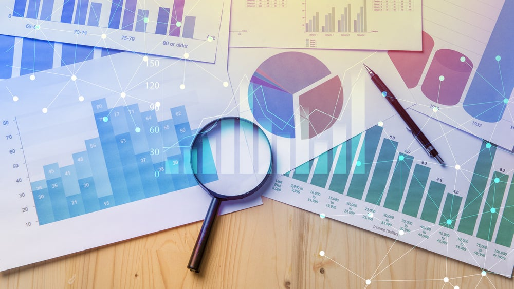 A selection of analytical charts and a magnifying glass