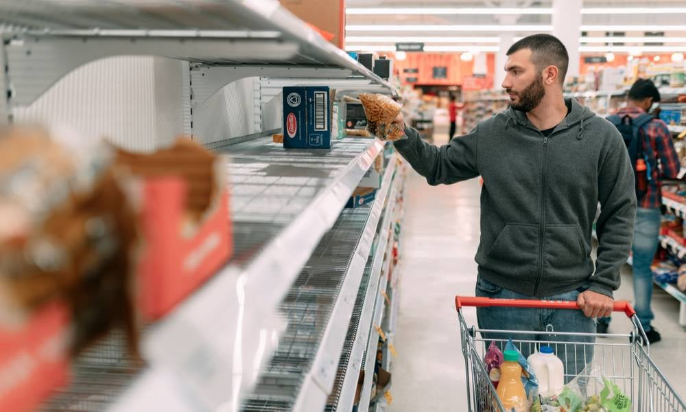 Man shopping at Woolworths during COVID-19 pandemic.jpeg