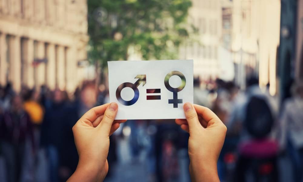 Hands holding male female gender equlity sign.jpeg