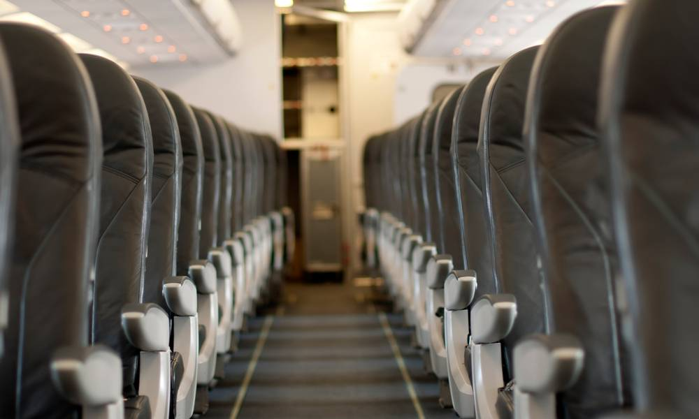 Rows of empty airline seats (1).jpg