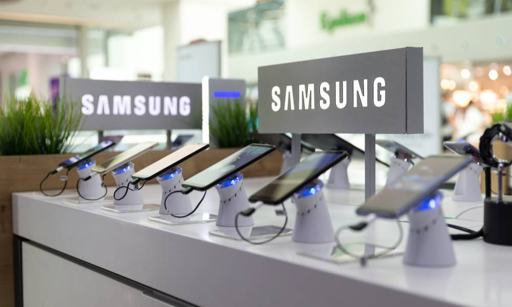 Samsung Galaxy Smartphones are shown on display in electronic store with brand logo in the background.jpg