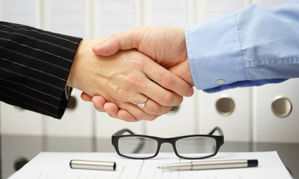 Businessman and client are handshaking over agreement (1).jpg
