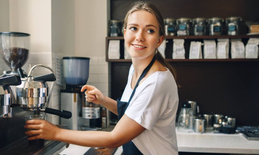 Young female barista fills a cup with espresso (1).jpg