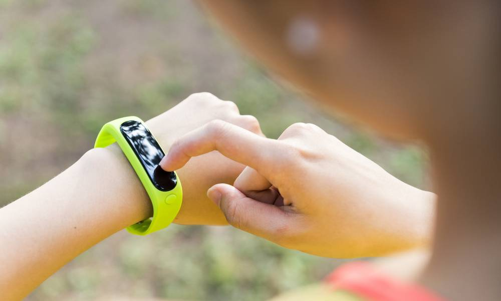 Woman exercising with fitbit.jpg