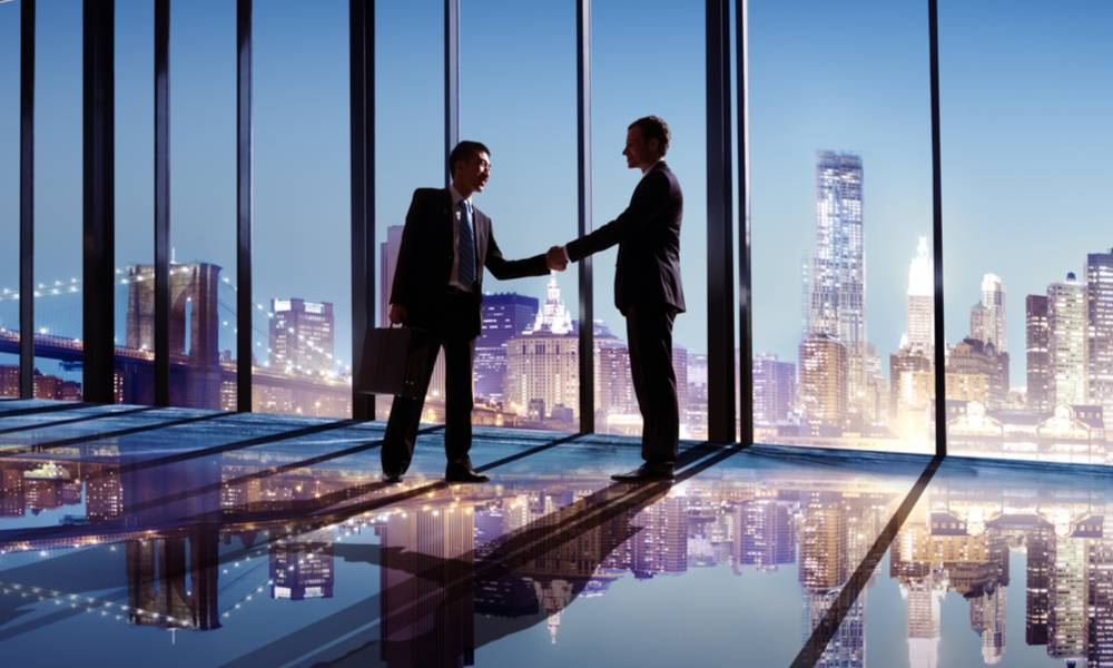 Businessmen shaking hands with city view (1).jpg