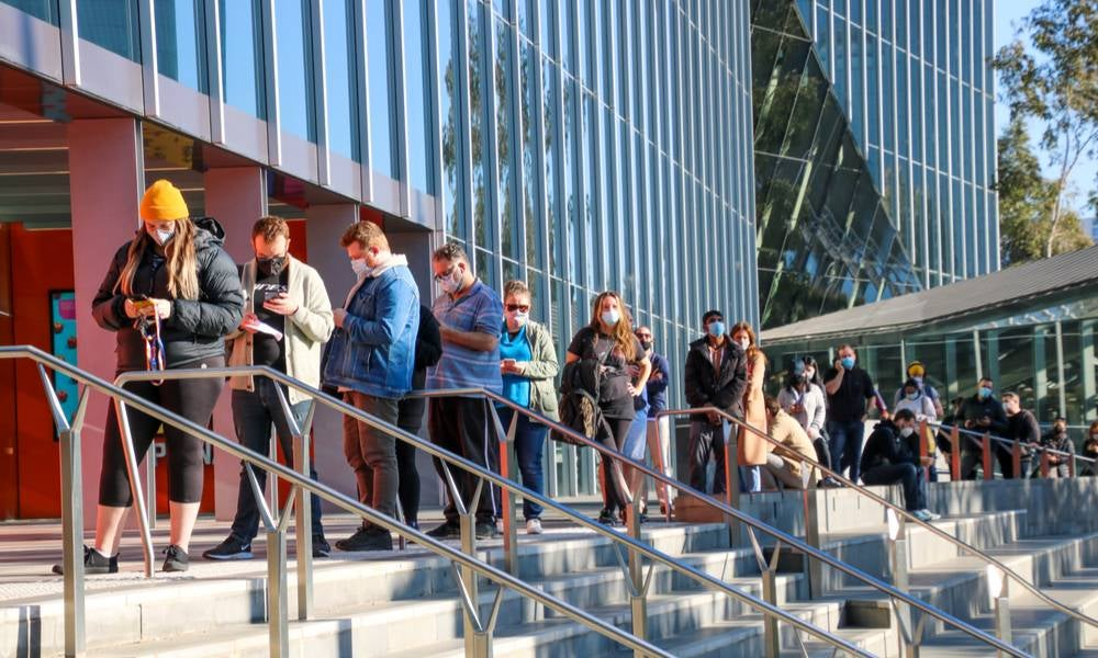 A long queue of people waiting to get vaccinated against covid19 at melbourne convention centre covonavirus vaccination hub..jpg