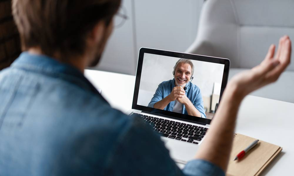 Leader talks to employee virtually communicating to gain trust during uncertainty.jpeg