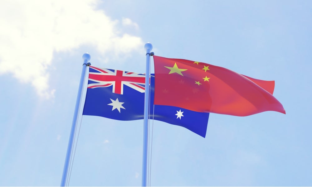 Australian and Chinese flag blowing in the wind-min.jpg