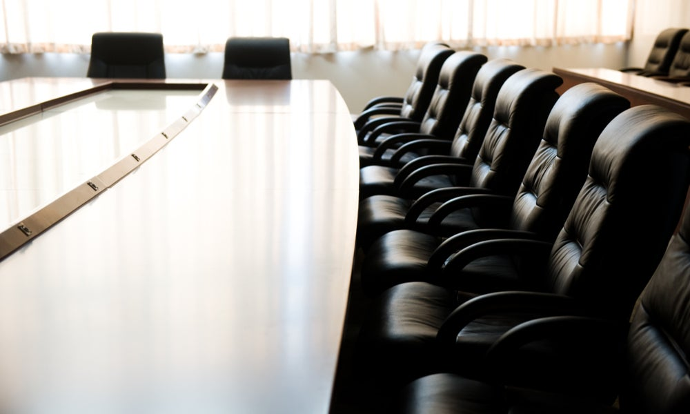Empty boardroom table and chairs-min.jpg