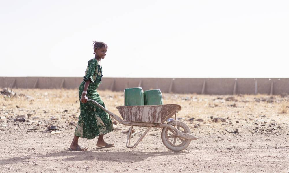 Girl carrying fresh water for lack of water symbol (1).jpg