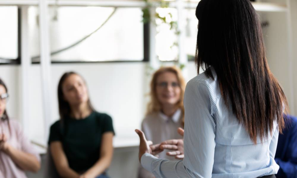 Female leader shares information with employees building trust in a time of uncertainty.jpeg