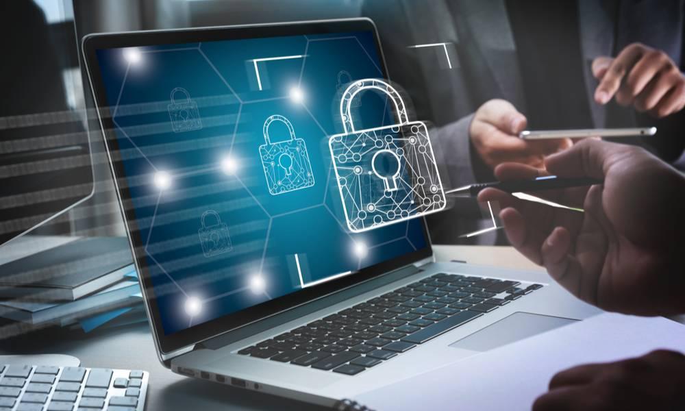 Man installing firewall antivirus  on laptop (1).jpg