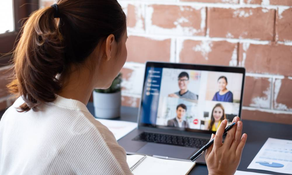 Young Asian businesswoman work at home and virtual video conference meeting with colleagues business people, online working, video call due to social distancing at home office.jpeg