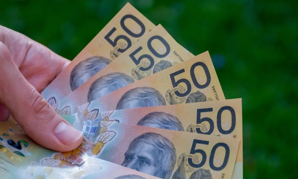 Handful of fifty dollar bills.jpg