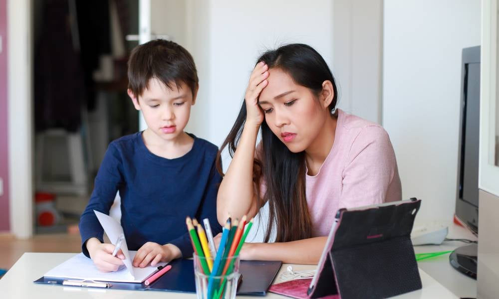 Woman is homeschooling her child instead of work gender inequality in the labour force leads to underemployment .jpeg