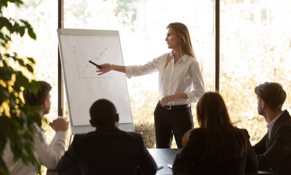 Businesswoman presenting investment growth figures to colleagues (1).jpg