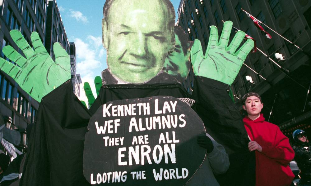 Protesters hold up an effigy of Enron's Kenneth Lay during a march against the World Economic Forum on February 2, 2002 in New York City.jpg