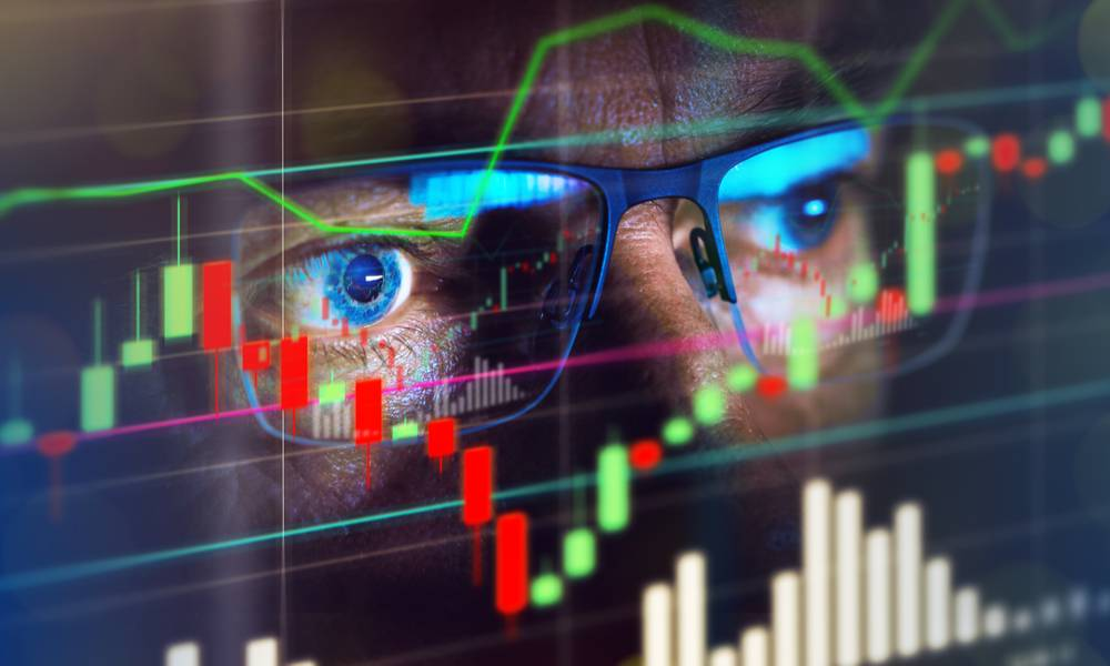 Close up of stock market trader looking at graph of share prices (1).jpg