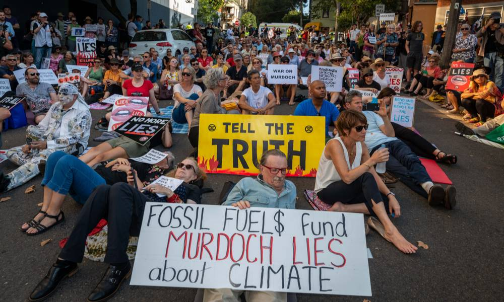 Hundreds of climate activists lie down in front of News Corp Australia headquarters calling the Murdoch press liers.jpg
