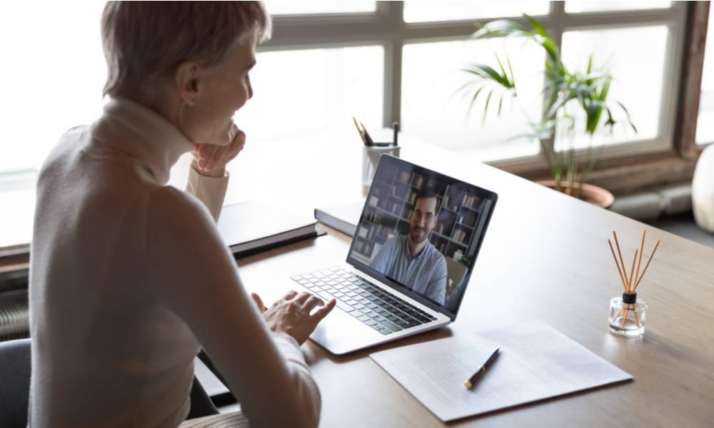 Woman conducts virtual interview.jpeg