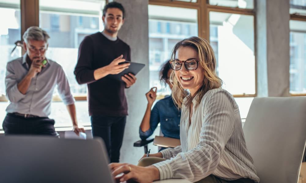 Entrepreneurs in a room working together.jpeg