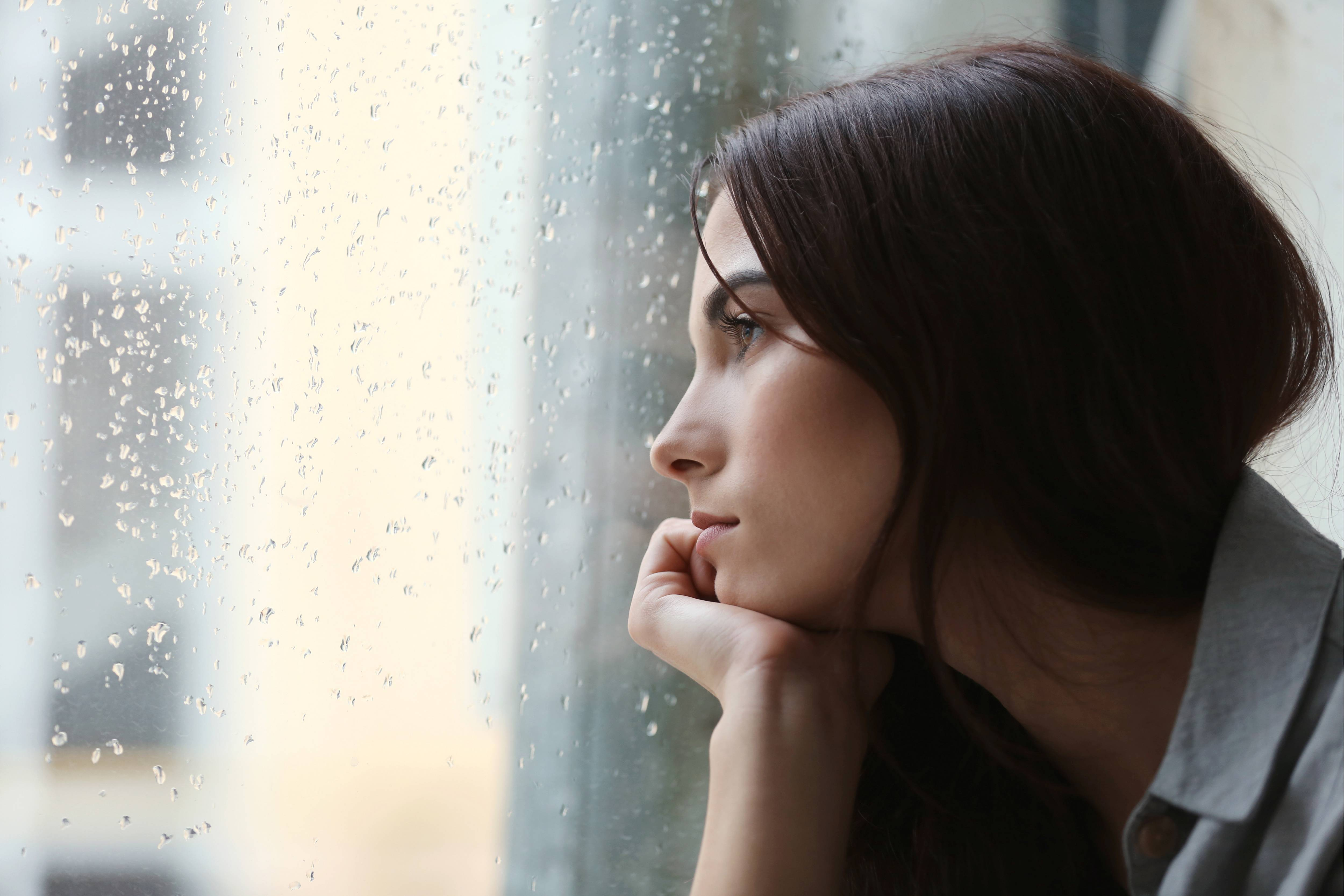 Woman stares out of window into the rain  (1).jpg