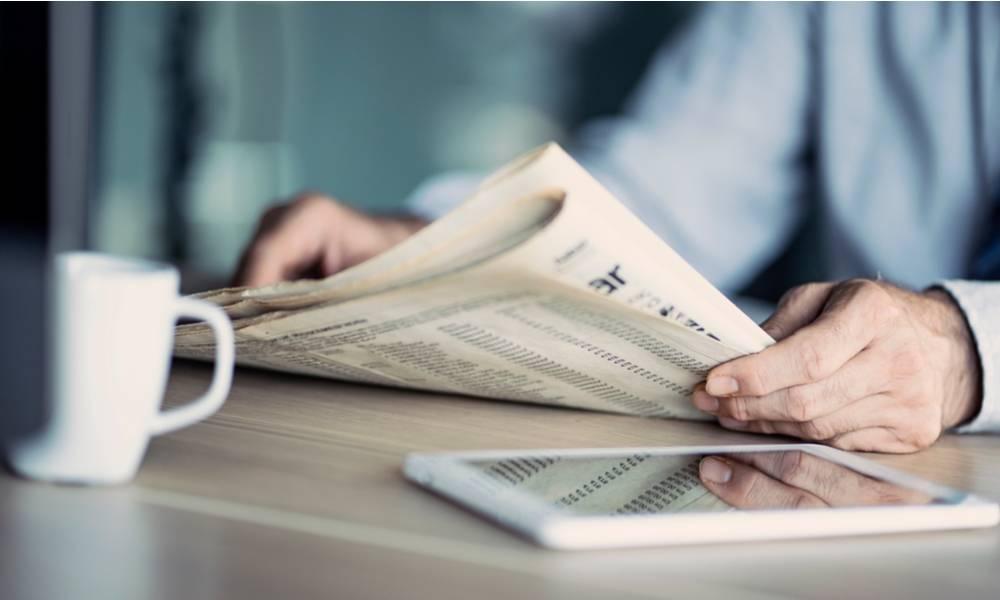 Businessman reading the newspaper on table (1).jpg