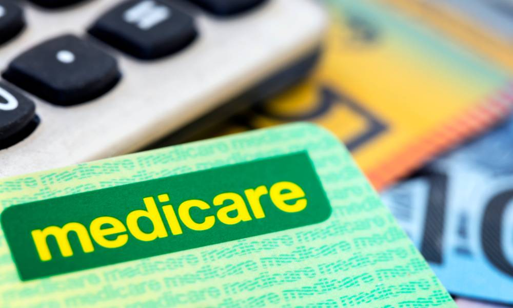 Australian Medicare card with calculator and cash background.jpg