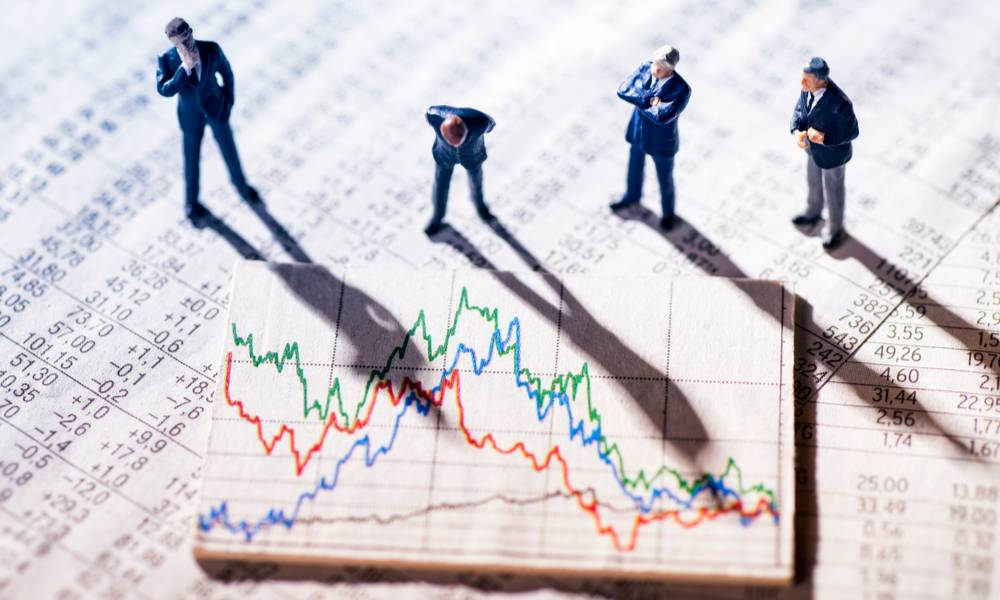 Puzzled men in suits crowded around a stock chart (1).jpg