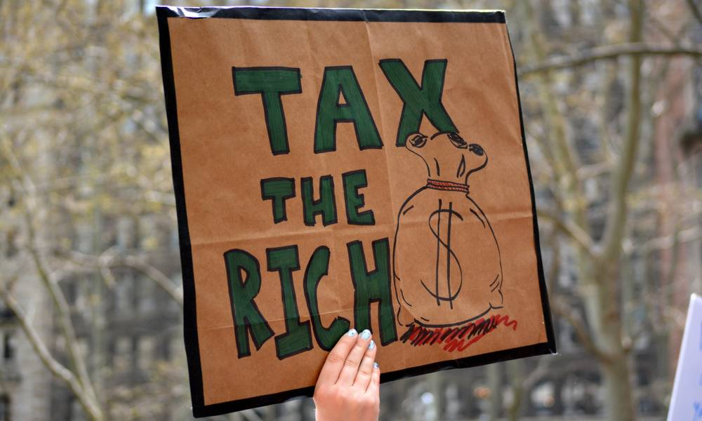 Sign says tax the rich.jpeg