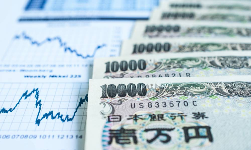 Japanese Yen bank note with stock graph.jpg