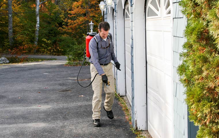 technician treating home in maine