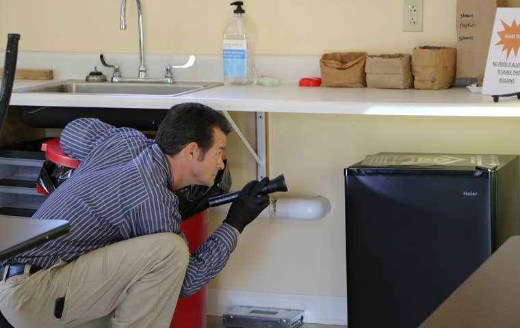technician inspecting a home in maine