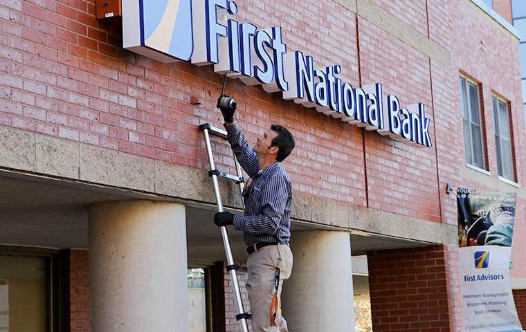 technician treating a commercial building in maine