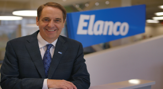 Jeff Simmons standing in front of the Elanco logo