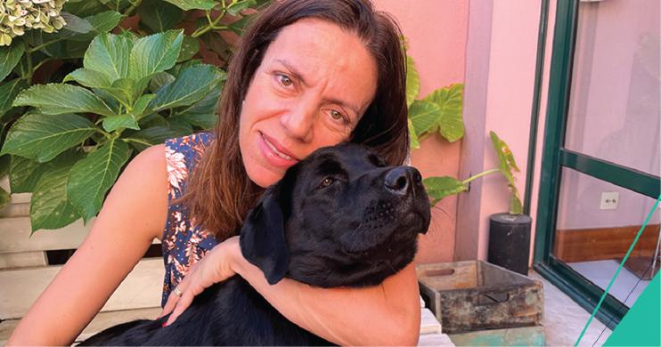 Margaria Alves giving her dog a hug