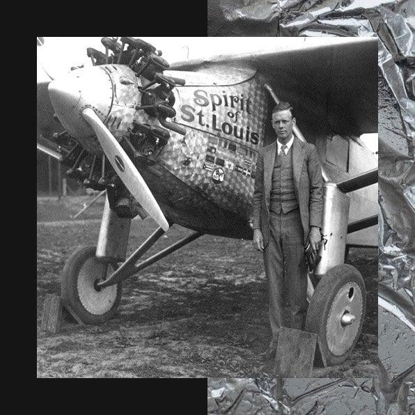 Man next to Spirit of St. Louis airplane