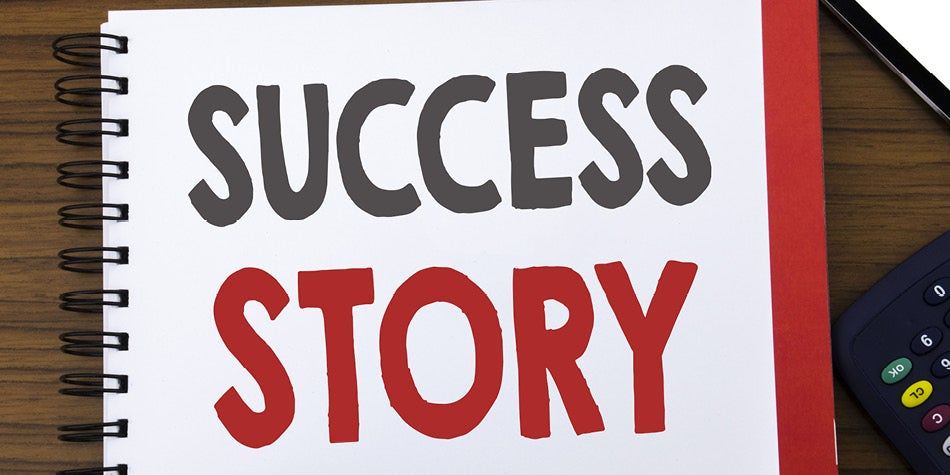 Success Story words written on a notebook