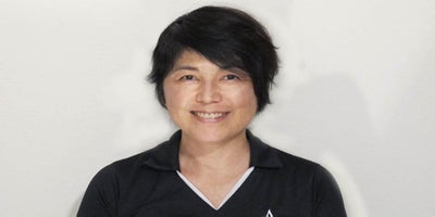 Smiling face of Akiko Hashido, a team member at Andrews Institute