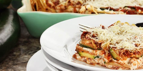 Zucchini noodles arranged like lasagna with pizza-Italian flavors and topped with cheese
