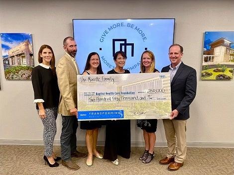Morette Family , KC Gartman and Mark Faulkner holding big check