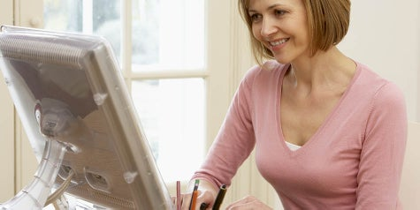 Woman working on a computer from home in a personal space