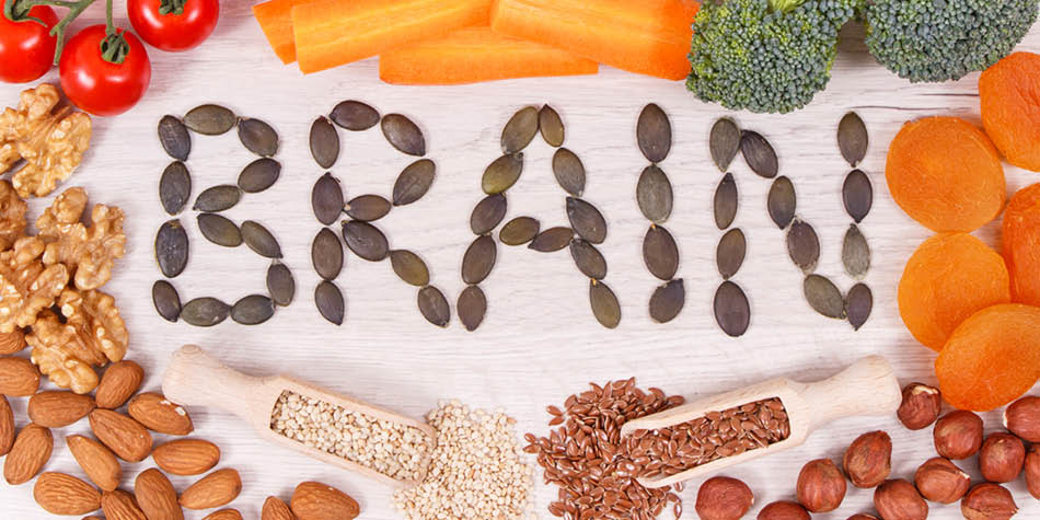 The word BRAIN is spelled out with seeds with nutritious foods surrounding it