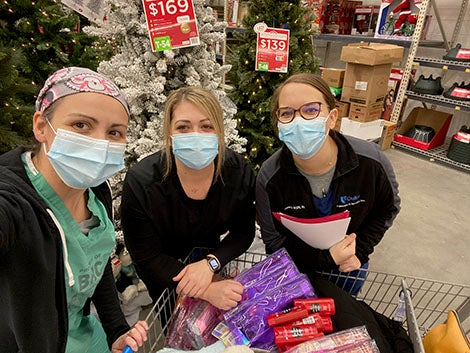 three ladies buying gifts