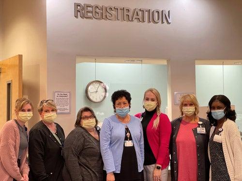 Baptist Medical Park - Nine Mile registration team members pose for camera.
